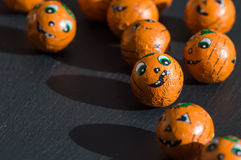 Halloween treats with cute faces and shadows. stock images