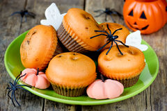 Halloween treats for kids - pumpkin chocolate muffins, fondant p royalty free stock image