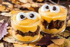 Halloween treats, little monster dessert Stock Photos