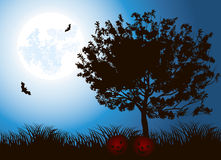 Halloween Tree. Against the night sky with a full moon Stock Photo
