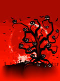 Halloween Tree with Bats and Pumpkins. EPS 8 Stock Image
