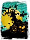Halloween tree and pumpkins Stock Photos