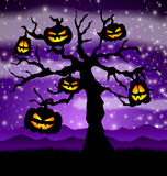 Halloween tree with pumpkins Royalty Free Stock Images