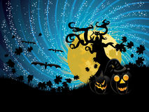 Halloween tree and pumpkins Royalty Free Stock Photo