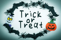 Halloween Trick or Treat Background with Spiders Bats Pumpkin and Ghost Royalty Free Stock Photography