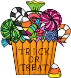 Halloween trick or treat bag filled with candies Royalty Free Stock Image