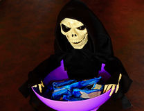 Halloween Trick Treat Candy Bowl. Scary Halloween Trick Treat Candy Bowl stock photo