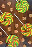 Halloween Trick or Treat rainbow lollipops overhead Stock Photo