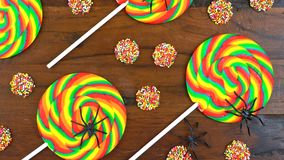 Halloween Trick or Treat rainbow lollipops overhead Royalty Free Stock Photo