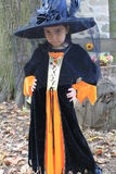 Halloween Trick - or - Treater in her costume Stock Photo