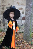 Halloween Trick - or - Treater in her costume Royalty Free Stock Images