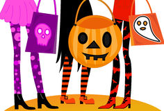 Halloween Trick or Treaters. Girls night out dressed in Halloween costumes with fun goody bags.  Ready for Trick or Treating or going to clubs or parties Stock Photo