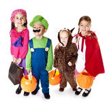 Halloween Trick-or-Treaters. Four Halloween Trick-or-Treaters all dressed in their costumes Stock Images