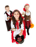 Halloween: Trick Or Treaters with Flashlights. Halloween series with cute children dressed as Dracula, a pirate, and Little Red Riding Hood.  Isolated on white Royalty Free Stock Image