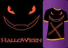 Halloween Tshirt. Orange Tshirt with the word Halloween with a scary face Stock Photography