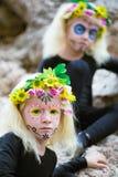 Halloween twin girls outdoors Stock Photography