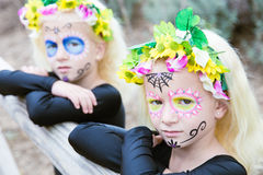 Halloween twin sisters with sugar skull makeup Royalty Free Stock Images