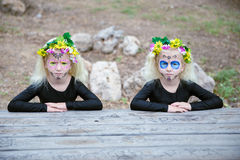 Halloween twin sisters on a table Royalty Free Stock Images