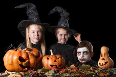 Halloween. Two little witches, skull surrounded by Stock Images