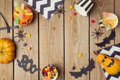 Halloween-vakantieachtergrond met pompoen en suikergoed royalty-vrije stock foto's
