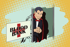 Halloween. Vampire at entrance to blood bank. Royalty Free Stock Photography