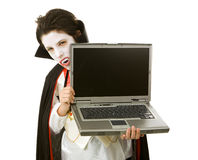 Halloween Vampire with Laptop. Cute Halloween vampire holding a laptop computer over white background.  LCD screen is blank and ready for your text Royalty Free Stock Photos