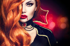 Halloween vampire woman portrait. Beautiful glamour fashion sexy vampire Royalty Free Stock Image