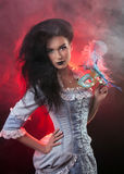 Halloween vampire woman with venetian mask Stock Photography