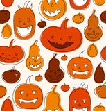 Halloween vector seamless pattern with angry pumpkins. Decorative drawn background with funny drawing pumpkins. Royalty Free Stock Images