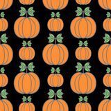 Halloween vector seamless pattern. Decorative background with funny drawing pumpkins. royalty free illustration