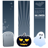 Halloween Vertical Banners. A collection of three Halloween vertical banners with a tombstone, a scary black pumpkin and a spooky ghost on gray background. Eps vector illustration