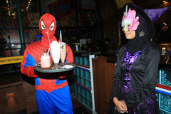 Halloween. Waiter and visitor restaurant wearing a ghost costume during the celebration of Halloween in the city of Solo, Central Java, Indonesia stock photos