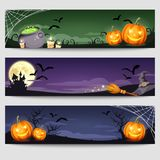 Halloween web banners. Vector eps-10. Vector Halloween web banners with jack-o-lanterns, cauldron, candles, castle, moon, witches hat and broom, spider web and Royalty Free Stock Image