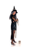 Halloween witch. Young woman, Halloween witch with scary expression. Studio, white background Royalty Free Stock Image