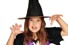 Halloween witch. A girl in a witch's costume making a scary face Royalty Free Stock Photo