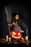 Halloween witch. With a pumpkin Royalty Free Stock Image