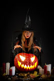 Halloween witch. With a pumpkin Royalty Free Stock Images