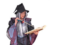 Halloween witch. With magic wand  reading spells in book. holiday, fear concept Royalty Free Stock Images