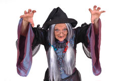Halloween witch. Scary looking Halloween witch, raised arm, clawed hands , holiday, fear concept Stock Photography