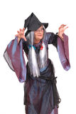 Halloween witch. With scary expression, raised clawing hands, dressed up in costume Stock Images