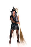 Halloween witch. Young woman, Halloween witch with scary expression. Studio, white background Royalty Free Stock Images