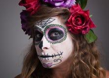 Halloween witch. Beautiful woman wearing santa muerte mask portr Stock Photography
