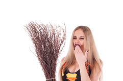 Halloween witch in black dress with broom Stock Images
