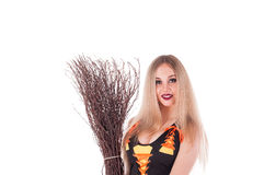 Halloween witch in black dress with broom Stock Photo