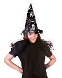 Halloween witch in black dress and hat. Royalty Free Stock Image