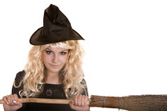 Halloween  witch  in black dress and hat on broom. Stock Images