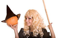 Halloween witch in black hat  with pumpkin. Royalty Free Stock Image