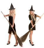 Halloween witch blond in black dress, hat, broom. Stock Photography