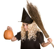 Halloween witch blond in hat and pumpkin, broom. Royalty Free Stock Images