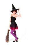 Halloween witch with a broom Royalty Free Stock Images